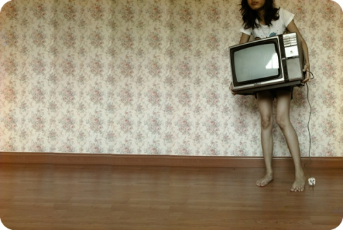 girl-carrying-tv